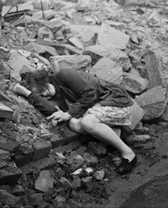 A woman cries in the ruins of Dassau, 1945.