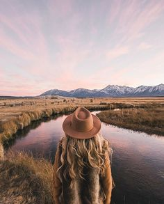 Girl lookout out at a beautiful landscape, calm river, curly blonde hair, brown felt hat, snow topped mountains Adventure Awaits, Adventure Travel, All Nature, Adventure Is Out There, Oh The Places You'll Go, The Great Outdoors, Travel Inspiration, Travel Photography, Photography Ideas