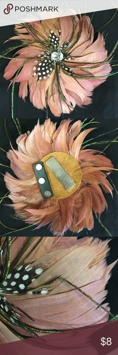 Feather Magnetic Pin Pretty dusty rose colored feather pin. Has some wear. You can see one peacock feather is bent. Very strong magnetic clasp. Great for using as a pin on clothes, pocket books, and even a hair piece. 5 inches in diameter. Boutique Jewelry Brooches