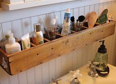 Organizing tip: Use an old wooden CD tower to shelve odds and ends cluttering your bathroom counter.