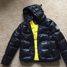 RLX technical down coat By Ralph Lauren She'll and lining are nylon. Filling is 80% down 20% feathers. Machine wash, tumble dry w tennis balls. Adjustable bungee hem. Double adjustable hood. Too swim and bottom up zippers. Interior zip pocket. Packs into it own interior pocket, pic 2. Ralph Lauren Jackets & Coats Puffers