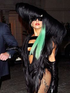 GAMMING IT UP  Lady Gaga dares to bare yet again in another hair-raising ensemble Thursday while stepping out in London.