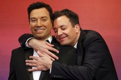 Jimmy Fallon looks so happy with his statue.