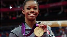 Team USA's Gabrielle Douglas smiles on the podium  Gabrielle Douglas of the United States celebrates on the podium after winning the gold medal in the Artistic Gymnastics women's Individual All-Around final on Day 6.