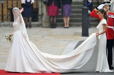 April 29, 2011: Kate reveals her Alexander McQueen wedding dress to droves outside Buckingham Palace along with sister Pippa, also in McQueen.