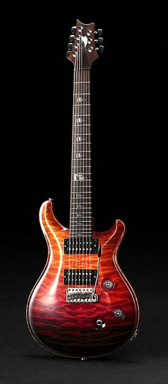 PRS Private Stock 7-String. Really awesome guitar, fire ombre effect.