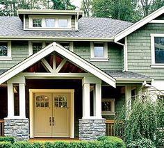 Doors & columns with covered front porch...like this look as long as there is a big back porch