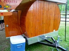 A handmade camper made from tongue & groove boards by John Castell.  Inside he has a flat screen TV & a fireplace!  It looks like a gypsy caravan, chuck wagon, &/or a sheep herder's camper all rolled into one.  It took him only three weeks to build it!  Check out his website:  www.teardropsbyjohn.webs.com