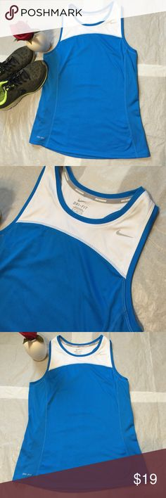 NWOT Nike Dri-Fit Racer Back Tank-Size Medium NWOT Nike Dri-Fit Racer Back Tank-Size Medium. Washed but never worn! Super Stylish! Nike Running, 100% Polyester. Originally $30 on the Nike website! Fast Shipping! Smoke Free Home! 🚭 Open to Offers on my Items or 15% off Bundles! 🚀Top 10% Seller!🚀 Nike Tops Tank Tops