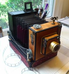 Is it REALLY a Camera? This holds 60 photos. By Carole Parsons