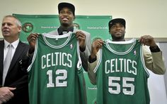 JaJuan Johnson and E'Twaun Moore, both currently playing for the Boston Celtics.