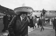 1960s image, Manchester United great George Best arriving back in England at Ringway after beating Benfica in Lisbon, Portugal.