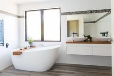 Freestanding bathtub and white floating vanity with timber top. Bathroom with white wall tiles and timber look floor tiles. Bathroom Floor Tiles, Bathroom Wall Decor, Bathroom Interior Design, Bathroom Furniture, Vanity Bathroom, Wall Tiles, Bathroom Ideas, Grey Bathrooms, White Bathroom