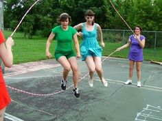 This is pretty daring but real fun Double Dutch also Chinese jump rope made with rubber bands attached together and wrapped around two peoples ankles facing each other around six or seven feet apart.