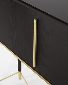 The satin brass detailing on this Tama Secrétaire desk provides an elegant design.