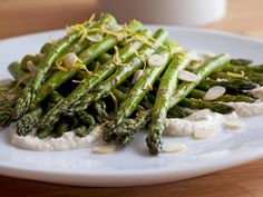 Healthy Roast Asparagus with Creamy Almond Vinaigrette : While your asparagus is roasting, use the blender to make a quick, dairy-free vinaigrette with almonds, lemon juice and olive oil.