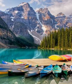 Canoeing at Moraine Lake in Lake Louise, alberta. One of the top 10 places to visit in your lifetime. Beautiful blue glacier fed lake