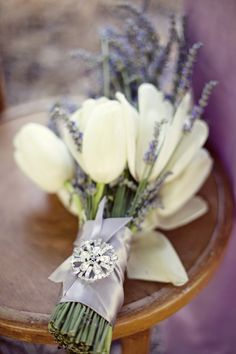 You can never go wrong, in my book, with tulips. This bouquet is stunning with the combination of the white tulips, lavender, gray satin ribbon and gorgeous brooch.