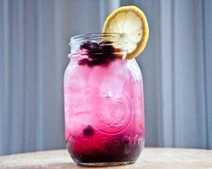 Blueberry Vodka Lemonade: Vodka, 1/2 cup fresh blueberries, 1/2 cup frozen blueberries, 1 teaspoon sugar, lemonade, and lemon slices for garnish.