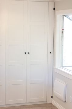 Ladies and gents, I present to you our finished Ikea Pax Pantry:Let's first back up to where we left off in my last post…The pantry was up, but with no hardware, crown molding, or insid… Ikea Pantry, Pantry Laundry Room, Ikea Kitchen, Kitchen Pantry, Kitchen Decor, Laundry Nook, Corner Wardrobe Closet, Wardrobe Doors, Wardrobe Ideas