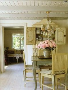 French Cottage the huge arrangement of roses is stunning and certainly a focal piece in such a beige setting.
