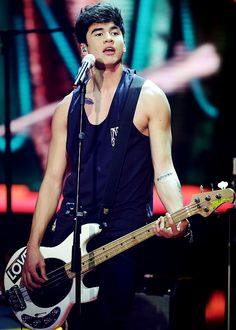 5 Seconds of Summer perform during the Italian State RAI TV show final 'The Voice of Italy' in Milan on June 5, 2014.