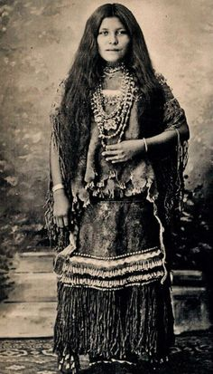 Isabelle Perico Enjady, in a puberty dress. Chiricahua Apache, daughter of Perico, prisoner of war (POW), Fort Sill, Oklahoma. Picture taken between 1887-1914.