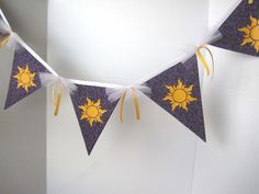 7 Flag Tangled Sun Banner -   Rapunzel Party Decorations / Tangled Bedroom Decor. $25.00, via Etsy.