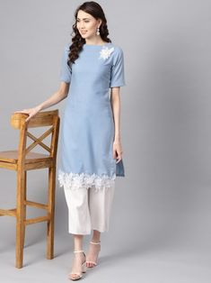 Blue solid straight kurta with lace detail, has a boat neck, short sleeves with ruffled detail, straight hem, side slits