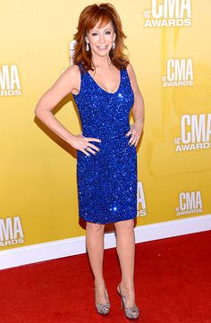 Country music legend Reba McEntire stunned in a sparkly bright blue number at the CMA Awards.
