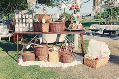 Picnic Basket Party...baskets are filled with food.Blankets are laid on the ground...guest just pick a spot and enjoy the afternoon.Great  idea for the 4th of July.