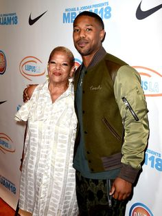 Actor Michael B. Jordan (R) and his mother Donna Jordan attend the Michael B. Jordan and Lupus Annual LA event at Dave and Busters on July 2018 in Los Angeles, California. - Michael B. Jordan And Lupus LA Present Annual - Red Carpet Michael Bakari Jordan, Jordan Photos, American Actors, Red Carpet, Chef Jackets, Jordans, Presents, July 28, Coat
