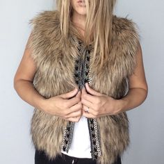 Miss Me beaded faux fur vest Miss Me Beaded Faux Fur vest NWT. Made of (fur pile) 100% acrylic, (fur back) 100% polyester, (contrast) 100% acrylic, (lining) 100% polyester. Faux fur means that it is not real fur. Front has 4 hook closures. Size Small. Measurements:  Underarm to underarm flat across is approximately 16 inches. Back of neck to bottom of hem is approximately 20 inches. Miss Me Jackets & Coats Vests