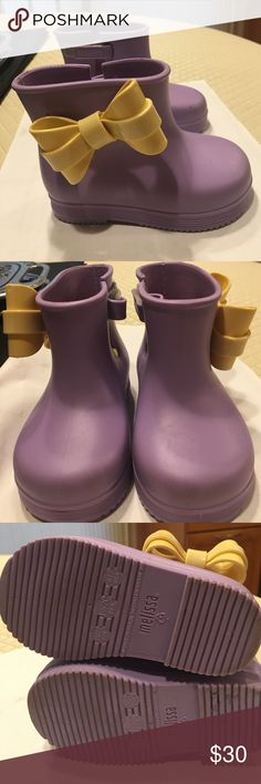 Mini Melissa purple boots with yellow bow Adorable worn a few times as we grew out of them quickly. Excellent condition look brand new. Size 6/7 but more like a 6. Mini Melissa Shoes Rain & Snow Boots