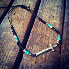 Black and turquoise beaded sideways cross by RainingRustic on Etsy, $20.00