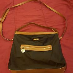 Sale till tomorrow! Michael Kors purse Authentic Michael Kors  Black and tan shoulder or cross body purse in great condition Michael Kors Bags Crossbody Bags