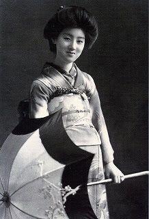 Portrait of the Geisha Sakae with an umbrella, date unknown.