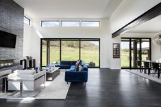 White Modern Barn House by Jaffa Group - MyHouseIdea