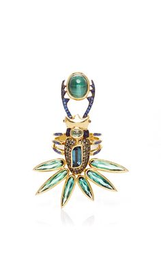 This**Daniela Villegas** ring features a miniature rendition of a bug clasping a stunning tourmaline stone, which epitomizes the designer's inspiration from the goddess, Devi