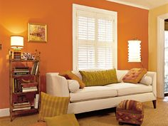 tangerine orange living room with white furniture, love the use of