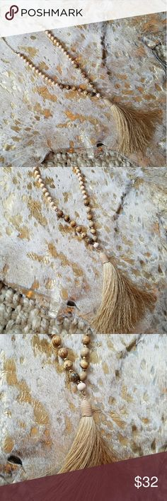 """Tassel Necklace Beautiful tassel necklace in neutral colors with gold accents. The entire necklace measures approximately 33"""" The tassel measures approximately 4"""" New, no tags Jewelry Necklaces"""