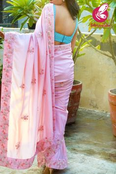 Leave a lasting impression on the rest of the crowd as you wear this beautiful Baby Pink Pure Silk Pearl Hand Embroiered Saree that comes with a Pastel Blue Pearl Hand Embroidered Crepe Blouse Piece. Team it with high heels for an absolute stunning look Crepe Saree, Chiffon Saree, Silk Chiffon, Black Saree Designs, Saree Blouse Designs, Saree Painting, Silk Painting, Hand Work Blouse, Saree Trends