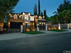 4778 Zelzah Ave, Encino, CA 91316   Zillow Family Room, Home And Family, Sliding Pocket Doors, Luxury Modern Homes, Waterfall Features, Bar Seating, House Blueprints, Living Room With Fireplace, Ceiling Beams