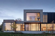 Contrasting finishes of concrete, brick, wood and aluminium fins form this country vacation home in Ballantrae in Whitchurch-Stouffville, Canada by Drew Mandel Architects. Dream Home Design, House Design, Glass Balcony, Building Elevation, Best Architects, House Entrance, Large Windows, Cladding, Decoration