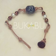Love this bracelet! Handmade Ceramic Bead Pearl Copper Button Leather by Bukabu,