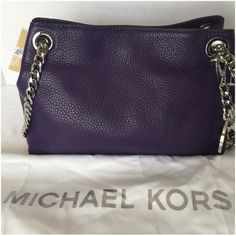 "Super Bowl Sale $165 MK Jet Set Messenger Michael Kors Jet Set Chain Medium Messenger in Iris. This color is sold out in stores and online. Made of pebble leather with magnetic snap closure. Signature logo hardware in silver.  Lined interior features zip pocket, credit card slots and key fob. Bottom width: 10"", depth 3 1/2"", height 7"", handle length 12"". Dust bag included. NWT Michael Kors Bags Shoulder Bags"