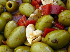 Seville Olives ~ Nothing quite like buyihng a kilo in the open market and savoring them as one shops the freshness of farmers' delights!  My nostalgia is 'fuerte!'