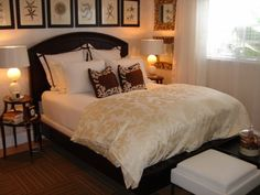 Curved Headboard with a Straight Line of Wall to Wall Art above it.