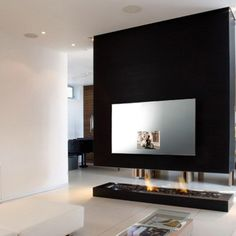 mirror tv with fireplace