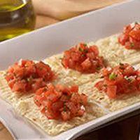 Olive Garden's Tomato-Basil Crostini Appetizer,   plum tomatoes, basil, extra virgin olive oil, salt, garlic, Parmesan cheese.